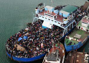 Hatian-earthquake-survivors-crowd-a-ship-Port-au-Prince-Haiti